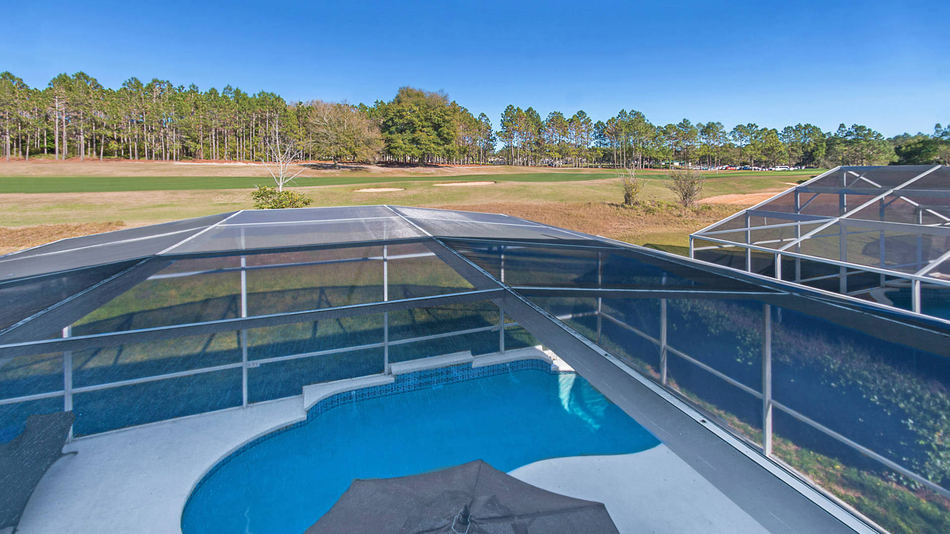 Pool with overlooking golf course disneymansion